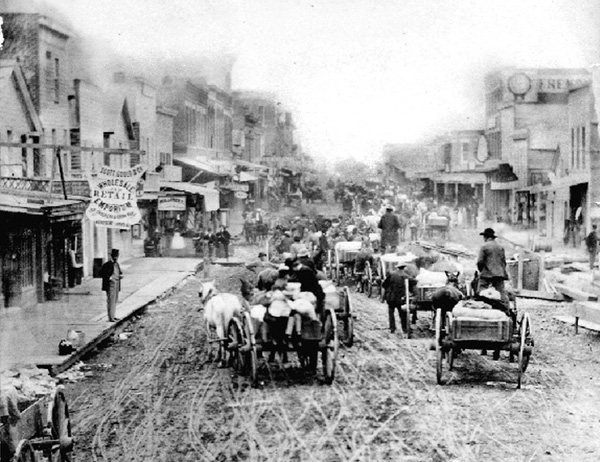 Photograph of a busy commercial street in McGregor, Iowa, 1870