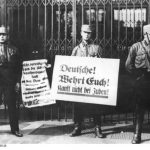 SA members holding posters declaring the Nazi boycott of stores with Jewish owners, April 1, 1933