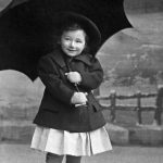 Otto Bettmann at two years with umbrella