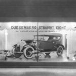 """Duesenberg straight eight, """"Built to outclass, Outrun and Outlast any car on the road,"""" ca. 1920-1930"""