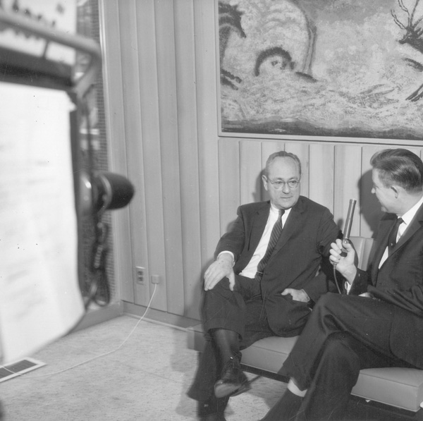 """Harold S. Hirsch being interviewed during filming of """"Success Story"""""""