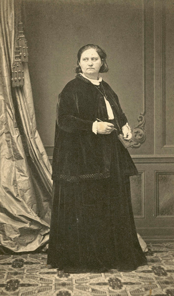 Mathilde Franziska Anneke wearing dark dress and coat, n.d.