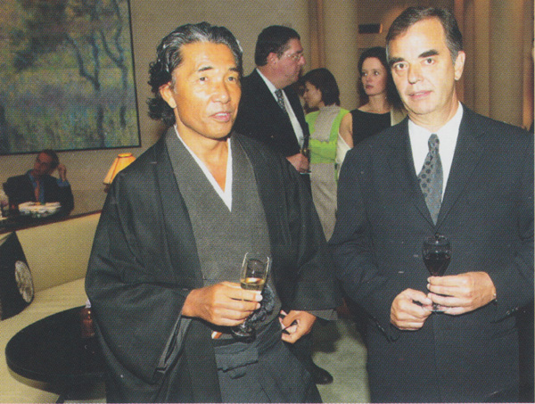 Bernd Chorengel discusses the architectural concepts of the Park Hyatt Paris-Vendôme with the designer Kenzo during the opening party of the hotel in September 2002
