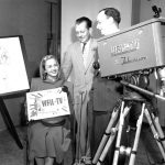 A woman holds a WFIL-TV sign, late 1940s