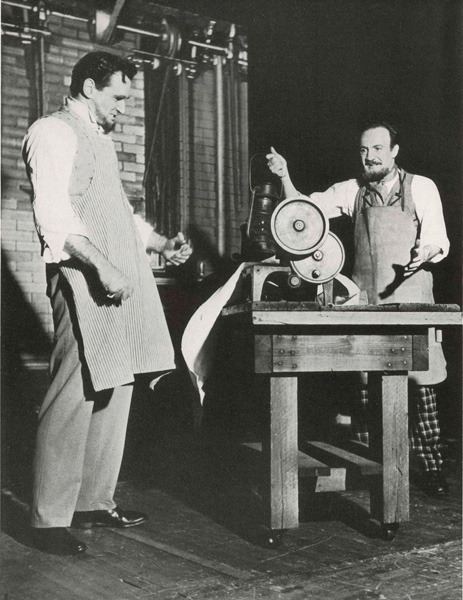Actor portraying Isaac M. Singer demonstrating his first sewing machine to printer George Zieber