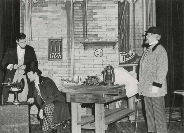 Actors portraying Isaac M. Singer and George Zieber examining a Lerow and Blodgett