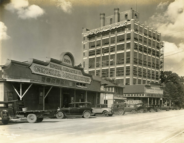 Imperial sugar mill and local stores in Sugar Land, Texas, ca. 1920s