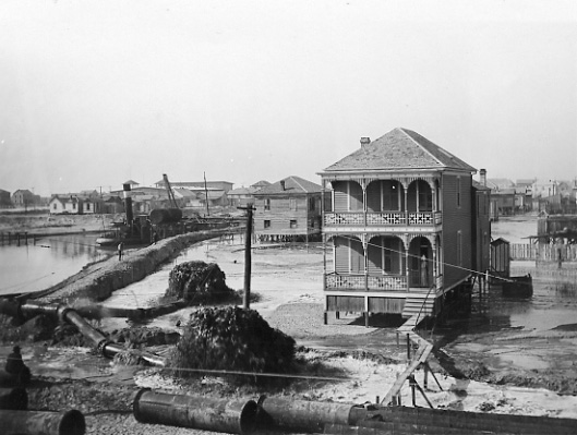 Raising the grade in Galveston to prevent flooding from future hurricanes, ca. 1905-1907