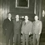 Kempner, Ike, Dan, Lee, and Stanley in front of a portrait of their father, Harris, n.d.