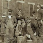 Six workers posing outside the August Schell Brewery, n.d.