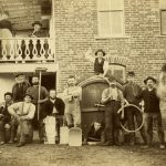 Brewery workers pose outside the August Schell Brewery, 1885