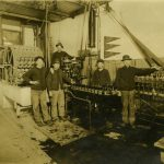 Six workers at the August Schell Brewery posing on the bottling line, n.d.