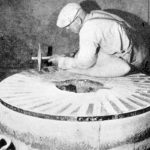Worker cleaning a millstone, n.d.
