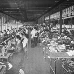 Stitching room in a shoe factory employing Singer sewing machines