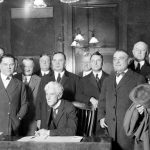 Judge Kenesaw Mountain Landis, commissioner of baseball from 1920 to 1944, with owners representing the sixteen American League and National League baseball teams, 1920