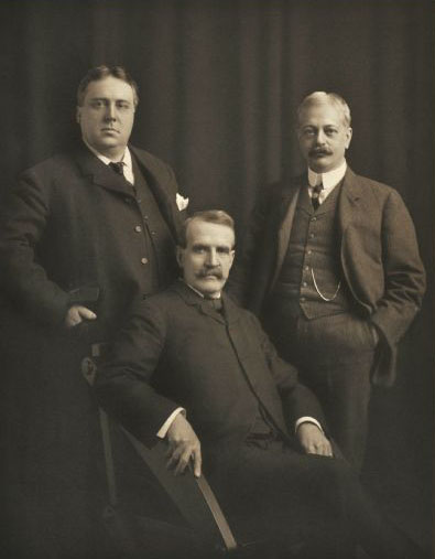 Studio group portrait of Charles F. Pfister, Henry C. Payne, and Frank G. Bigelow, 1902