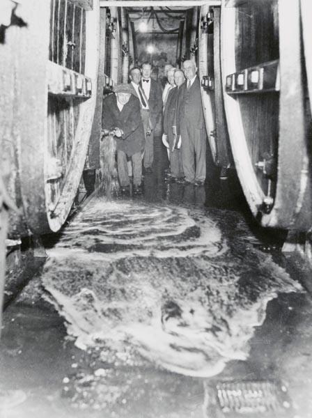Man Pouring Wine into Sewer, 1933