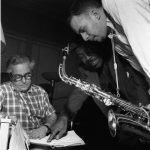 """Alfred Lion, Ike Quebec, and Jackie McLean at McLean's """"New Soil"""" session, 1959"""