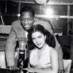 Ruth Mason and Herman Amis Broadcasting from the WOV Radio Booth, c. 1955
