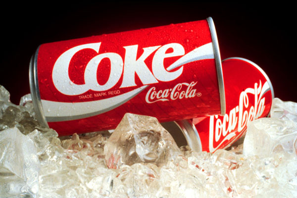 Coke Cans featuring updated design by Landor & Associates