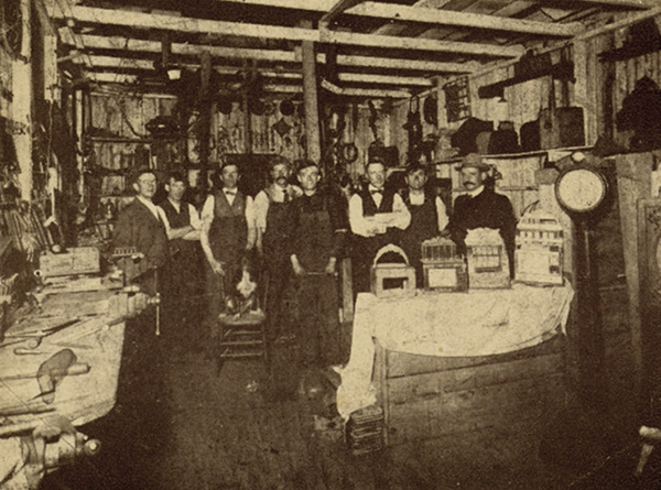 Charles Fey with his staff at their temporary factory following the San Francisco earthquake and fire of 1908