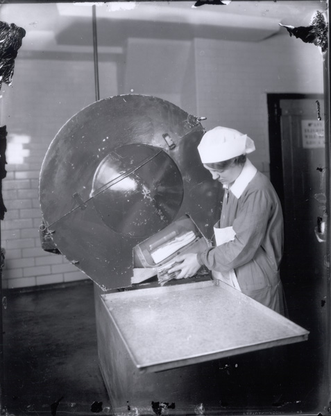 Woman slicing bacon, 1928