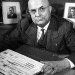 Henry J. Kaiser at his desk, 1943