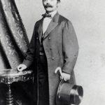 Heinrich (Henry) E. Steinway standing next to a table, Manhattan, 1850