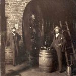 Jacob and Frederick Beringer in cellar with large wine barrel