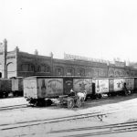 Anheuser-Busch Malt-Nutrine rail cars stand in front of the Manufacturers Railway Company, ca. late 1890s