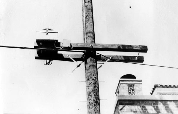 Amplifier installation on pole, 1957