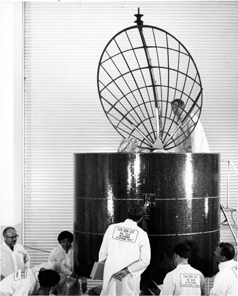 Hughes Aircraft engineers work on a satellite, 1972