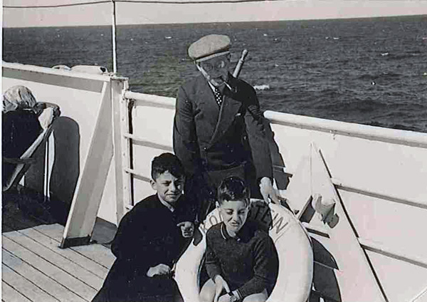 "Dan Aaron, his younger brother Franz, and their father Albert Aaron on the ship ""Königstein"" en route to America, 1937"