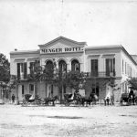 Menger Hotel with carriages, 1877