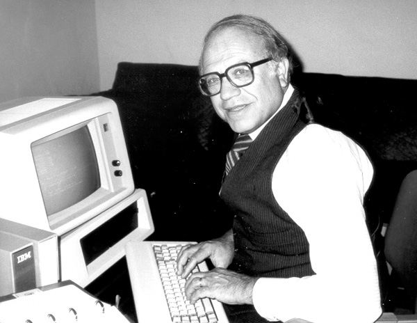 Werner Frank at one of the first desktop computers, 1981